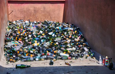 Helsinki, Finland - May 1, 2019: Pile of recycled sparkling wine bottles on a large open interchangeable platform after first of May celebrations in Kaivopuisto, Helsinki. Standard-Bild - 126613815
