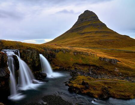 Kirkjufell (Church Mountain) mountain in Autumn colours in Snaefellsnes peninsula, Iceland on overcast early October afternoon in 2019. Standard-Bild - 136890748
