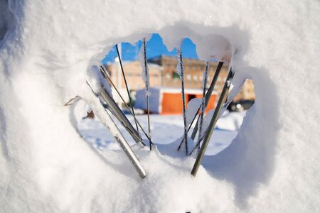 Market stalls at Kauppatori in Helsinki, Finland seen trough bicycle and its spokes covered with snow. Zdjęcie Seryjne