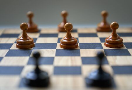 Concept chess pieces express social distancing