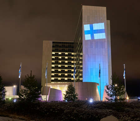 Helsinki, Finland - December 6, 2017: The Helsinki University Hospital in Meilahti decorated with blue and white colour lights and Finnish flag as part of the celebration of 100th anniversary of Finland's independence.