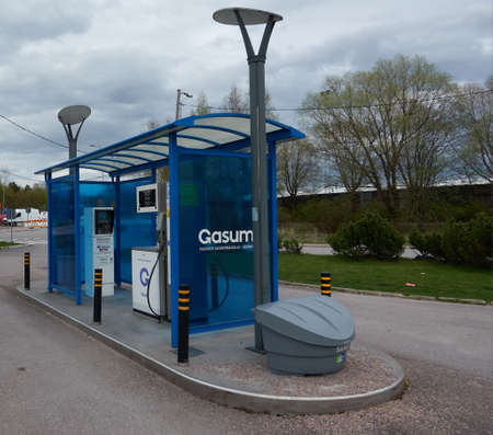 Espoo, Finland - May 6, 2020: Gasum gas company unmanned compressed natural gas (CNG) dispenser for cars that are able to utilize liquified natural gas (LNG) or biogas in their engines on cloudy day in May. Editorial
