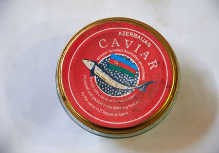 Baku, Azerbaijan - February 11, 2020: Red tin can of Azerbaijani caviar on sale at the Teze Bazaar in Baku, Azerbaijan.