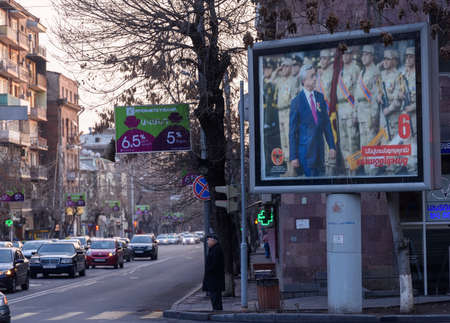 Yerevan, Armenia - April 1, 2017: Large size election poster of the Armenia's ruling party the Republican Party of Armenia (RPA) potraying President Serzh Sargsyan and armed forces on the side of the street in downtown Yerevan day before to Armenia's  Editorial
