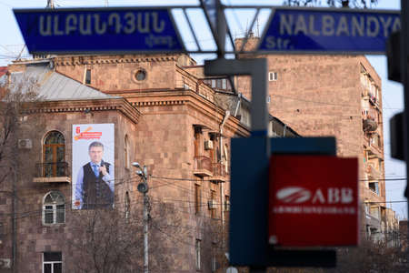 Yerevan, Armenia - April 1, 2017: Large size election poster of the Armenia's ruling party the Republican Party of Armenia (RPA) on the side of the building on Nalbandiyan street in downtown Yerevan day before to Armenia's parliamentary elections in A Editorial