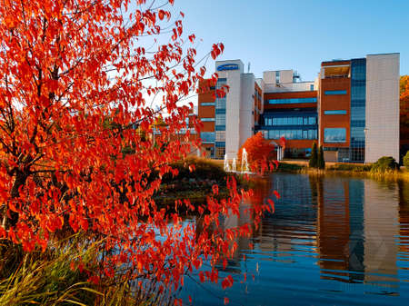 Espoo, Finland - October 1, 2019: Headquarters of the Orion corporation located in Espoo Finland on sunny October evening with Autumn colours on the foreground.