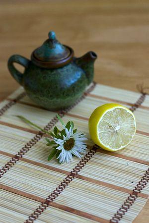 teapot and lemon on canvas