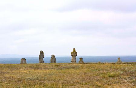 stone; statue; people; man; woman; men; thinker; wisdom; meditating; sculpture; standing; crowd;