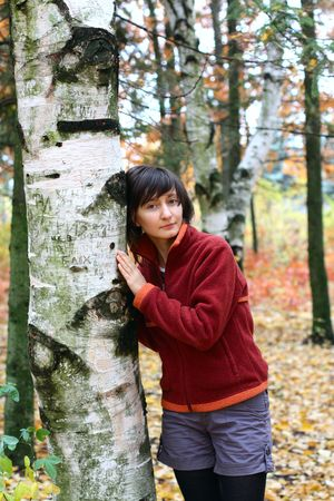 peaceful girl in a forest in autumn