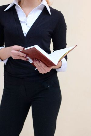 a busuness lady in a suit with notes