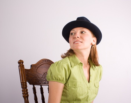 beautiful woman sitting on wooden chair Stock Photo - 10019233