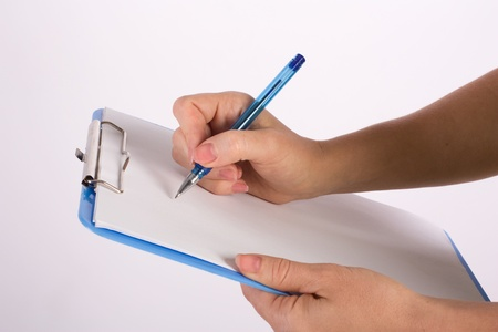 hand writing business ideas with pen