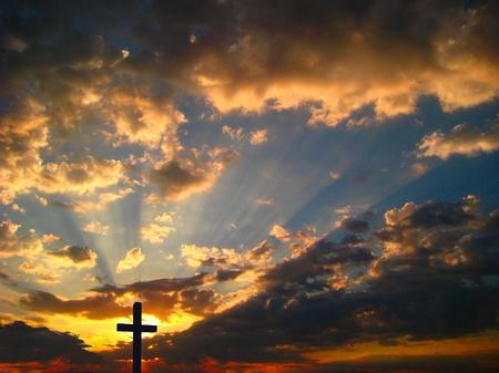 rayons croix coucher de soleil et Jésus