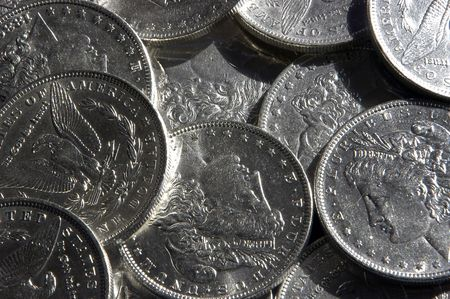 coinage: A collection of morgan silver dollars from the late 19th century. Stock Photo