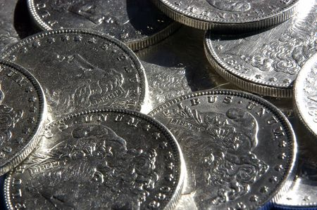 coinage: A collection of morgan silver dollars. Stock Photo