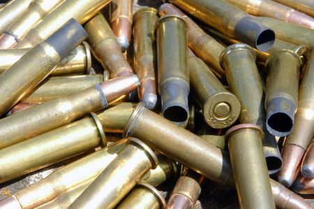 expended: A group of live bullets and expended shell casings.
