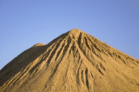 Sand pile with blue sky photo