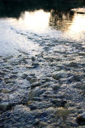 drava: River Drava, photographed near Varazdin. Small rocks in shallow water in deep blue color.