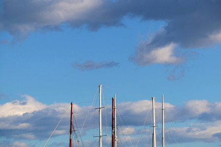 sailer: Sailing boats details, interesting clouds in the background.