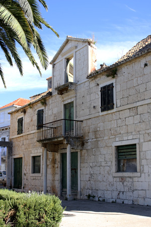 devastated: Old devastated building in the town centre in Sutivan Brac Island. Stock Photo