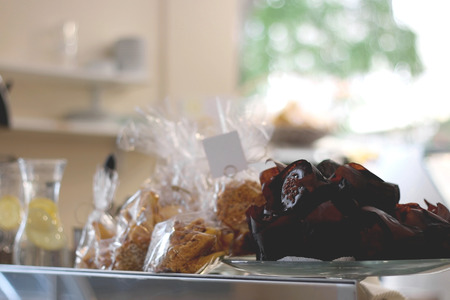 washed out: Chocolate muffins on a display at a pastry shop. Selective focus soft light washed out look.