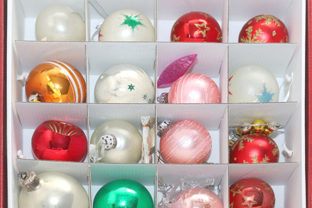 Colorful retro Christmas ornaments organized in a box. Top view.