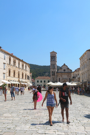 saint stephen cathedral: Hvar, Croatia - August 7, 2015: Tourists walking on Square of St. Stephen in town Hvar, island Hvar, Croatia. Cathedral of St. Stephen in the background. Hvar is famous Croatian touristic destination.