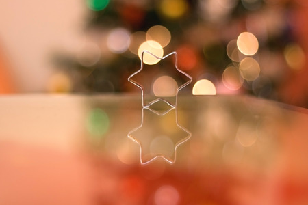 cookie cutter: Cookie cutter shaped like little star. Beautiful colorful bokeh in the background.
