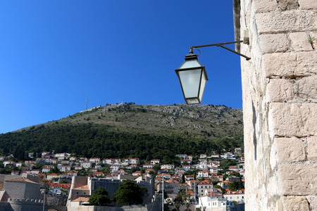 srd: Retro style street lamp in Dubrovnik. Selective focus. Stock Photo
