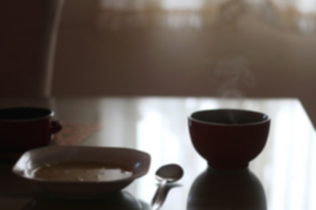 dim light: Lunch on the table with dim light and steam. Defocused.
