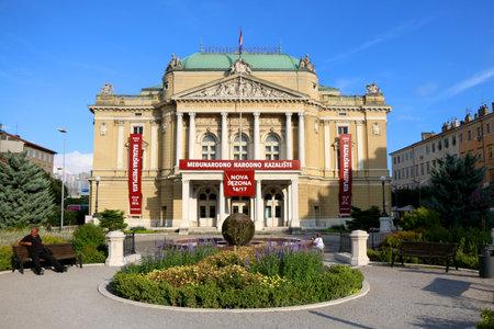 pl: Rijeka, Croatia - August 19, 2016: Croatian National Theatre Ivan pl. Zajc in Rijeka, Croatia. Abstract sculpture made by Dusan Dzamonja is in the front. Rijeka is selected as the European Capital of Culture for 2020.
