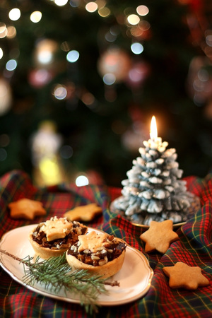 Christmas pastry filled with apples, almonds and chocolate with star shaped cookies. Selective focus and festive background.