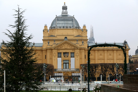 iceskating: Ice-skating rink and Christmas decorations in front of The Art Pavilion, landmark in Zagreb, Croatia. Advent in Zagreb Fair was voted as the European Best Christmas Destination for 2016. Stock Photo