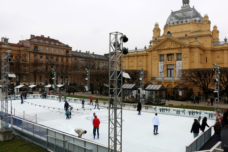 iceskating: Zagreb, Croatia - November 27, 2016: Ice-skating rink in front of The Art Pavilion, landmark in Zagreb, Croatia. Zagreb became popular European Christmas destination. Editorial