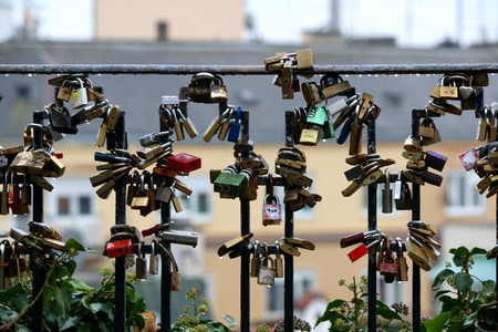 zagreb: Love locks on a fence in Upper Town, Zagreb, Croatia, on a rainy day. Selective focus. Stock Photo
