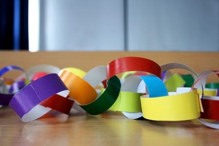 Do it yourself party decorations, made with colourful paper rings. Selective focus.