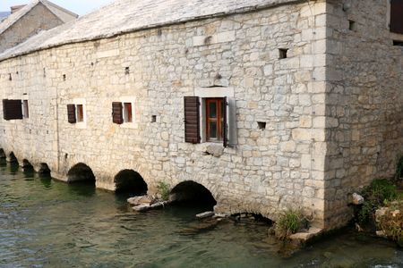 Traditional 17th-century watermill called Gaspina mlinica on river Jadro in Solin, Croatia. Architectural detail.