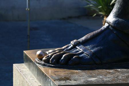 Statue of historic Croatian bishop Grgur Ninski. Lucky golden toe detail. Landmark in Split, Croatia.
