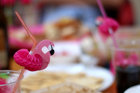 shallow dof: Birthday party with cute pink flamingo straws. Selective focus.