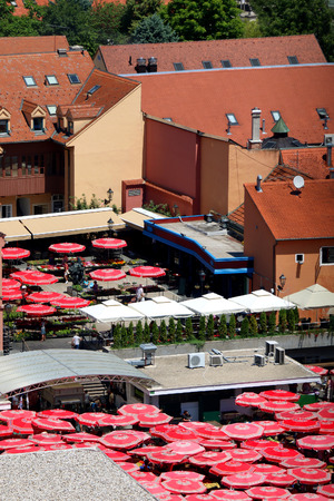 uptown: Dolac Market in Zagreb, Croatia with traditional Sestine Umbrellas. Aerial view.