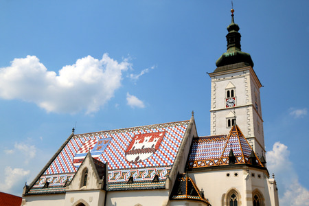 The Church of St. Mark, historic church in St. Marks Square, in Zagreb, Croatia. Roof tiles represent the coat of arms of Zagreb and Triune Kingdom of Croatia, Slavonia and Dalmatia.