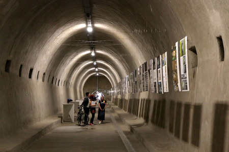 Zagreb, Croatia - June 19, 2017: Visitors at the annual Croatian architectural exhibition in tunnel Gric. Tunnel Gric is a WW2 tunnel in Zagreb Uptown. Its renewed and open for exhibitions.