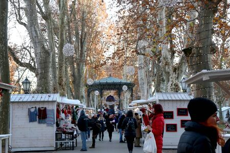 Zagreb, Croatia - November 29, 2016: People enjoying festive atmospehere on a Christmas fair in park Zrinjevac, Zagreb, Croatia. Zagreb is popular Advent travel destination.