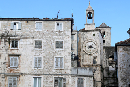 Historic buildings in Split, Croatia with landmark city clock. Split is popular coastal travel destination.