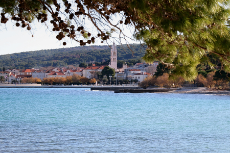Small town Supetar on island Brac, Croatia, surrounded with sea and pine trees. Selective focus.