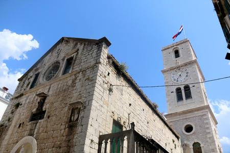 Traditional old Mediterranean architecture in Sibenik, Croatia on a beautiful suny day. Historic Church of Saint John the Baptist. Stock Photo