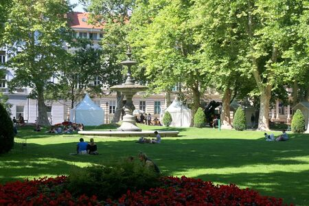 Zagreb, Croatia - June 20, 2017: Details in park Zrinjevac, in central Zagreb, Croatia. Tourists and locals ejoying sunny summer day in the park.