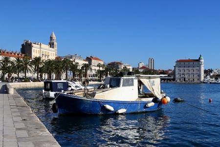 Historical architecture on Riva Promenade in Split, Croatia with landmark Saint Domnius bell tower.