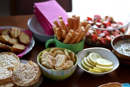 Table setting with galette, snacks, dips and salads. Selective focus.
