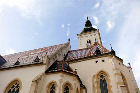 The Church of St. Mark, historic 19th century church in St. Mark's Square, in Zagreb, Croatia. Roof tiles represent the coat of arms of Zagreb and Triune Kingdom of Croatia, Slavonia and Dalmatia.